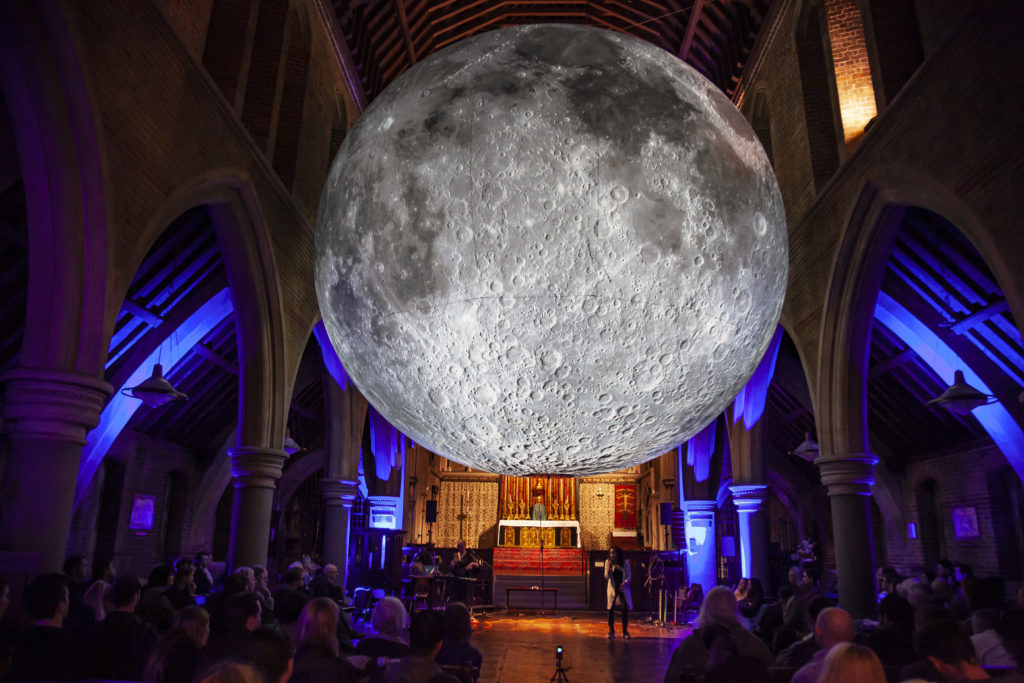 Greta Pistaceci and Laura Sampson beneath Luke Jerram's Museum of the Moon at LUNAR DREAMS, Fri 18th Oct 2019  (c) Bloomsbury Festival / Stuart Keegan